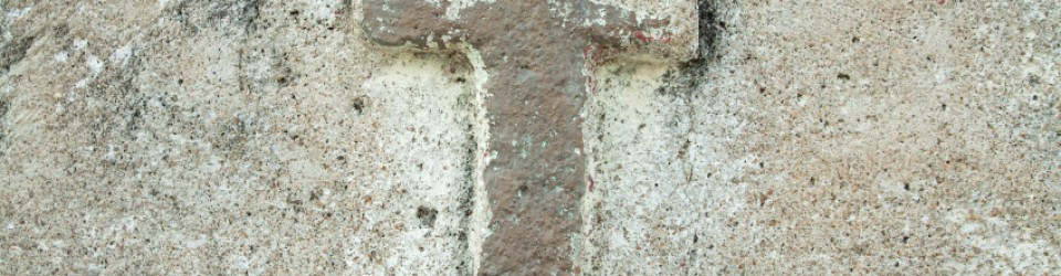 cross on old wall background